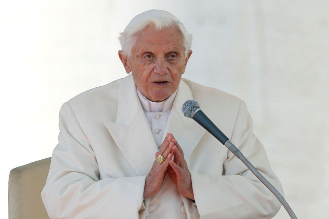 FILE PHOTO: Pope Benedict XVI finishes his last general audience in St Peter's Square at the Vatican February 27, 2013. REUTERS/Alessandro Bianchi/File Photo